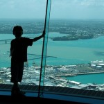 Sky Boy: Boy in Sky Tower. Auckland in background